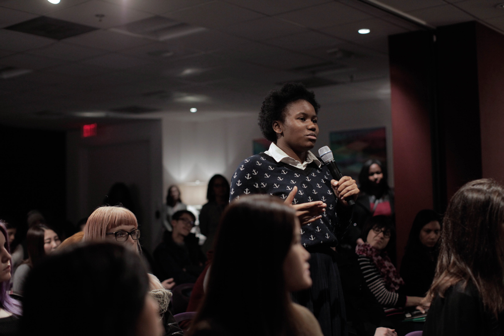 SCAD student directs her question to the panelists./Photo by Tyler McClelland.