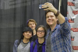 Josh McDermitt, who plays the character of Eugene on The Walking Dead, takes a selfie with fans. McDermitt was one of more than 30 cast members who attended Walker Stalker Con. Photo by Emma Dakin.